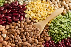 Various of legumes. With wooden spoon in grocery store royalty free stock photo