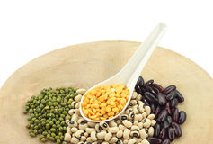 Various legumes with white spoon Stock Photography