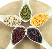 Various legumes with white spoon Stock Photo