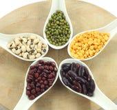 Various legumes with white spoon Stock Photo