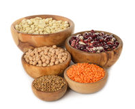Various legumes. In wooden bowl on white background royalty free stock photos