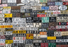 Various License Plates. Various retro License Plates on the wall Royalty Free Stock Image