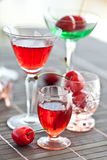 Various little glasses with cherry liquor Stock Image