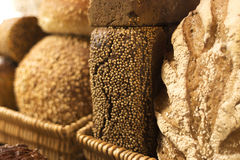 Various loaves of bread in baskets. Various different varieties of bread in baskets at bakery royalty free stock photography