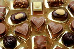 Various luxurious chocolates. Luxurious chocolates in a golden box Stock Image