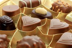 Various luxurious chocolates. Luxurious chocolates in a golden box Stock Photo