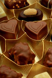 Various luxurious chocolates. Luxurious chocolates in a golden box Stock Photography