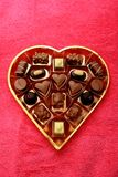 Various luxurious chocolates. Luxurious chocolates in a golden box Royalty Free Stock Photos