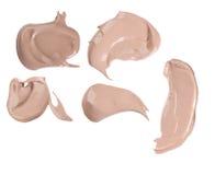 Various make up liquid powder strokes Royalty Free Stock Images