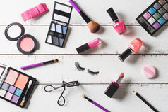 Various make-up products and cosmetics on wooden table Royalty Free Stock Image