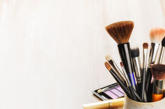 Various makeup brushes on light background Stock Photo