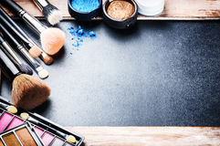 Various makeup products with copyspace Stock Images