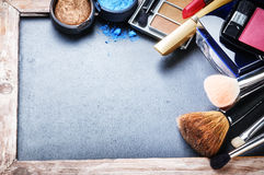 Various makeup products on dark background Royalty Free Stock Photos