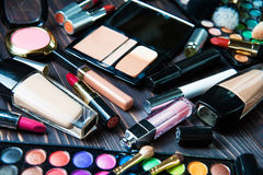 Various makeup products on dark background Stock Photos