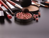 Various makeup products on dark black background with copyspace Royalty Free Stock Photo