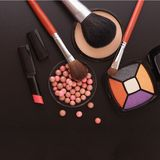 Various makeup products on dark black background with copyspace Royalty Free Stock Photos