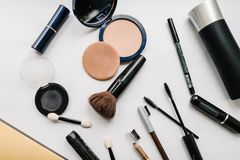Various makeup products: eyeshadow, brushes, powder, mascara. top view. royalty free stock photography
