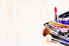Various makeup products on light background Stock Photo