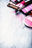 Various makeup products in pink tone Royalty Free Stock Images