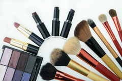 Various makeup products on white background with copyspace. Makeup products on white background with copyspace Royalty Free Stock Images