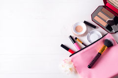 Various makeup products. On white wooden background with copyspace Royalty Free Stock Photos