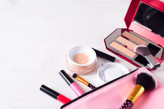 Various makeup products. On white wooden background with copyspace Royalty Free Stock Photography