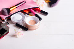 Various makeup products. On white wooden background with copyspace Stock Image