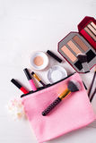 Various makeup products. On white wooden background with copyspace Stock Photos