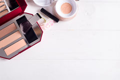 Various makeup products. On white wooden background with copyspace Stock Images