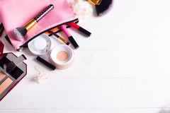 Various makeup products. On white wooden background with copyspace Royalty Free Stock Photo