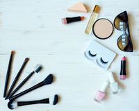Various makeup products on wooden background with copyspace Royalty Free Stock Photo