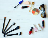 Various makeup products on wooden background with copyspace Royalty Free Stock Images