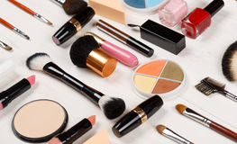 Various makeup products on wooden background Royalty Free Stock Photo