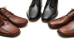 Various males shoes isolated on the white Royalty Free Stock Photos