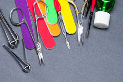 Various manicure tools on gray textured background Stock Images