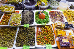 Various marinated olives in cans Stock Images