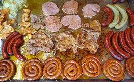 Various meat dishes at the Christmas market Royalty Free Stock Photography