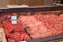Various meat in a supermarket. Raw meat at butcher shop. Various meat in a supermarket. Meat at butcher shop Stock Photography