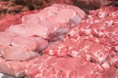 Close up of various meat in a supermarket. Raw meat at butcher shop. Various meat in a supermarket. Raw meat at butcher shop Royalty Free Stock Images