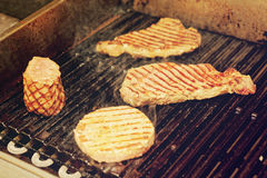 Various meats on grill, toned. Various meats on electric grill, toned image Stock Photos