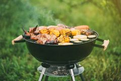 Various meats and vegetables on the grill royalty free stock photography