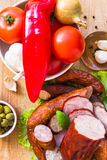 Various meats vegetables wooden table Royalty Free Stock Images
