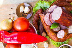 Various meats vegetables wooden table Stock Photography