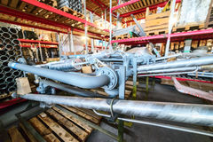Various mechanisms and gray metal pipe. Industrial Warehouse. Various mechanisms and gray metal pipe Royalty Free Stock Photo