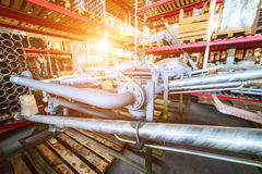Various mechanisms and gray metal pipe. Industrial Warehouse. Various mechanisms and gray metal pipe. Bright sunlight Royalty Free Stock Photos