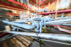 Various mechanisms and gray metal pipe. Industrial Warehouse. Various mechanisms and gray metal pipe. Motion blur effect Stock Image
