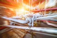 Various mechanisms and gray metal pipe. Industrial Warehouse. Various mechanisms and gray metal pipe. Motion blur effect. Bright sunlight Royalty Free Stock Image