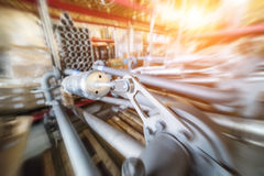 Various mechanisms and gray metal pipe. Industrial Warehouse. Various mechanisms and gray metal pipe. Motion blur effect. Bright sunlight Stock Photos