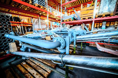 Various mechanisms and gray metal pipe. Industrial Warehouse. Various mechanisms and gray metal pipe. Toning the image Stock Image