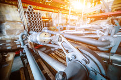 Various mechanisms and gray metal pipe. Industrial Warehouse. Various mechanisms and gray metal pipe. Toning the image. Bright sunlight Royalty Free Stock Photo